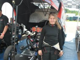 Stacy McGlory beside the Funny Car