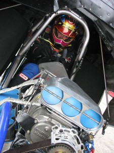 In the cockpit of her Girl Trouble Funny Car, Courtney Mageau
