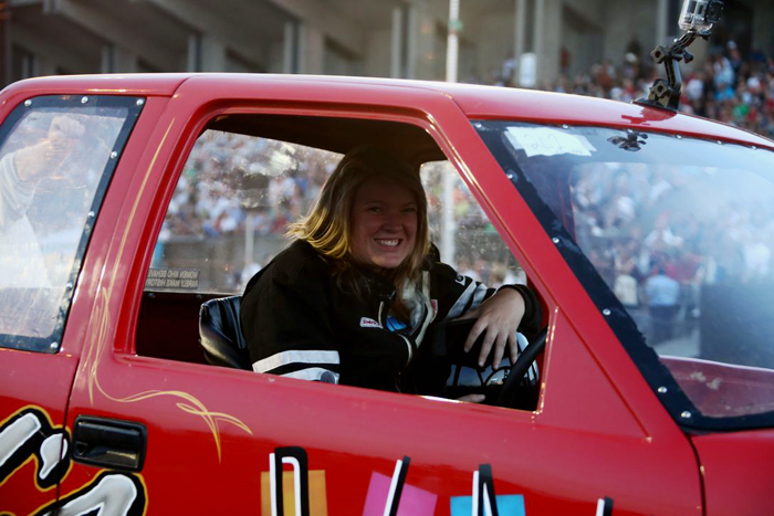 Mackenzie La Rue in the driver seat of Child's Play, her truck pullin S-10
