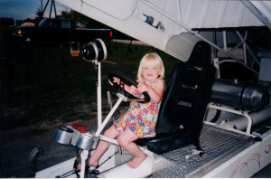 Mackenzie La Rue as a child in her father's truck